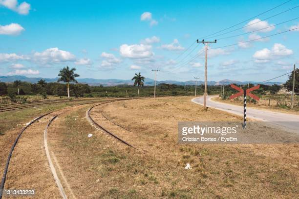 view of railroad tracks on field against sky - bortes stock pictures, royalty-free photos & images