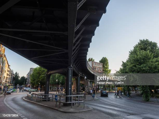 view of railway bridge in city against clear sky, kreuzberg, berlin - kreuzberg stock photos and pictures