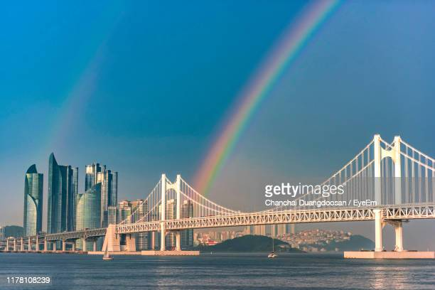 view of rainbow bridge over river - busan stock pictures, royalty-free photos & images