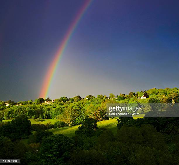 View of rainbow over countryside landscape