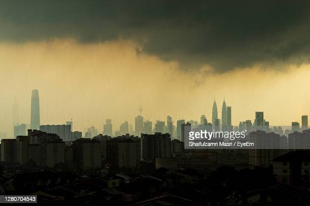 view of rainy day over down town kuala lumpur, malaysia. - shaifulzamri stock pictures, royalty-free photos & images