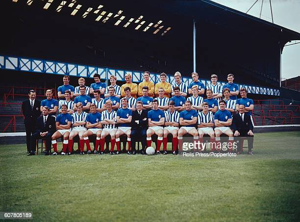 View of Rangers FC football team squad posed together on the pitch at Ibrox stadium in Glasgow Scotland on 9th August 1968 prior to the start of the...