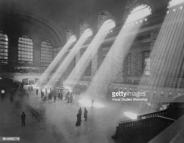 View of rays of light in Grand Central Station, New York, New York, circa 1930.