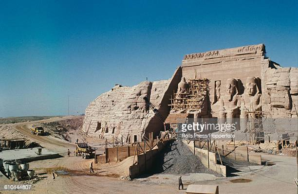 View of reconstruction work on the four statues of Pharoah Ramesses II at the Great Temple of Abu Simbel during final reassembly work after...