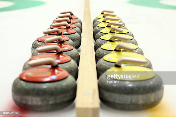 A view of Red and yellow stones on ice during the last day of qualifier for the Curling Japan Qualifying Tournament at Dohgin Curling Stadium on...