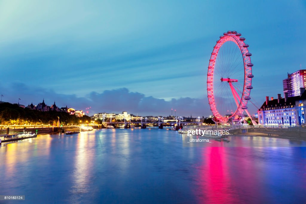 View of red London Eye and Hungerford Bridge at dusk : Stock Photo