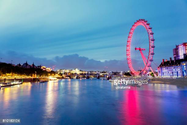 View of red London Eye and Hungerford Bridge at dusk