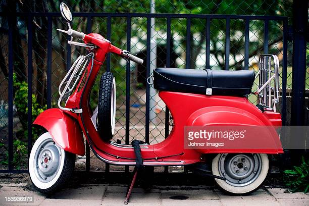 view of red motorbike - moped stock photos and pictures