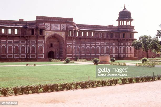 View of red sandstone walls outside the Jama Masjid Mosque, in the city of Fatehpur Sikri, located in the Agra district of Uttar Pradesh, India,...