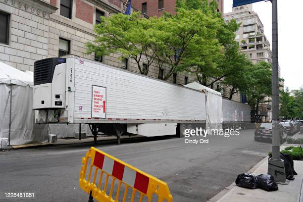 View of refrigerated trucks outside Lenox Hill Hospital during the coronavirus pandemic on May 17, 2020 in New York City. COVID-19 has spread to most...