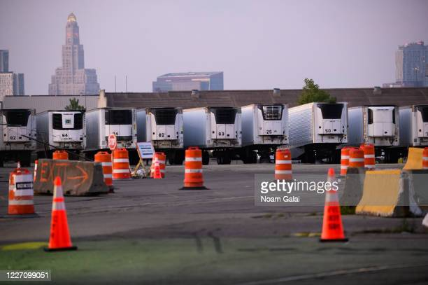 View of refrigeration trucks that function as temporary morgues at the South Brooklyn Marine Terminal during the coronavirus pandemic on May 25, 2020...