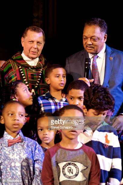 View of religious leaders and activists Father Michael Pfleger of St Sabina's Church and Reverend Jesse Jackson as they pose with a group of children...