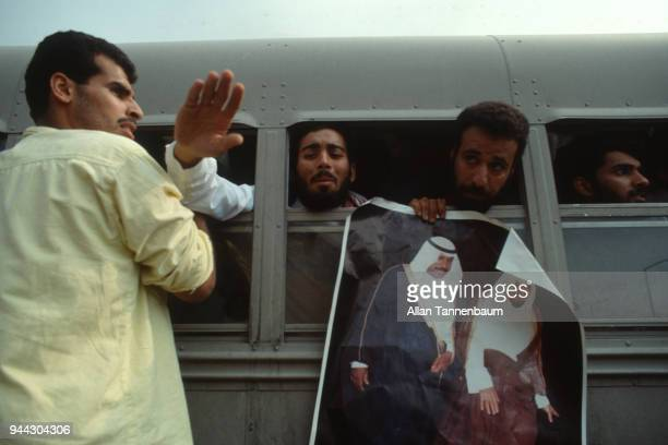 View of repatriated Kuwaiti Prisoners of War on a bus during the Gulf War Kuwait 1991