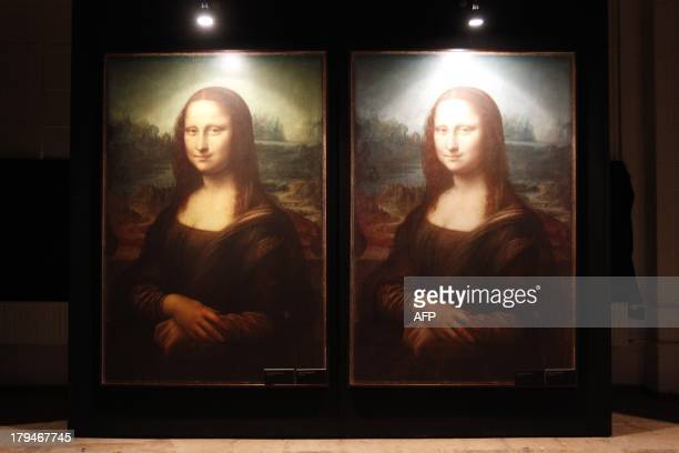 A view of reproductions of the Mona Lisa painting on display in the 'Da Vinci The Genius ' exhibition being held in the former post office in...