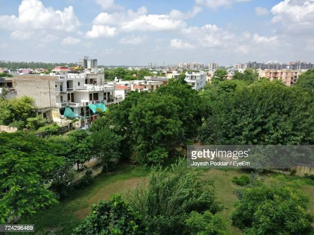view of residential buildings against cloudy sky - faridabad stock pictures, royalty-free photos & images