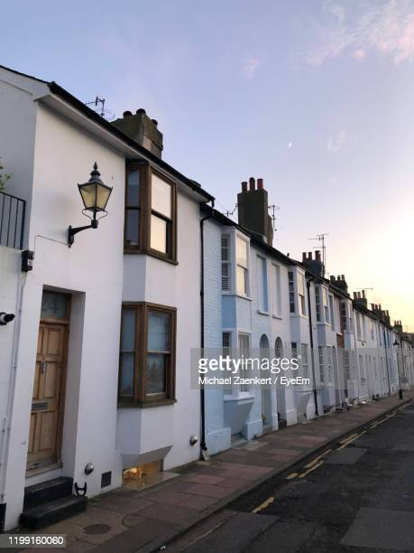 view of residential buildings against sky - brighton stock pictures, royalty-free photos & images