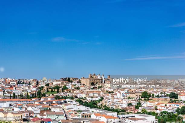 view of residential district against blue sky - extremadura stock pictures, royalty-free photos & images
