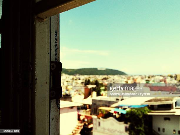 View Of Residential District Seen Through Window