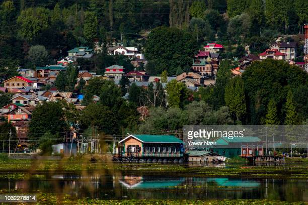 A view of residential houses located on the bank of Dal lake on September 12 2018 in Srinagar the summer capital of Indian administered Kashmir India...