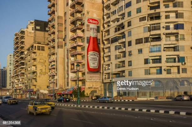 View of residential tower blocks one of which features a eightstory tall advertisement for Heinz ketchup on the ElGaish coastal road Alexandria Egypt...