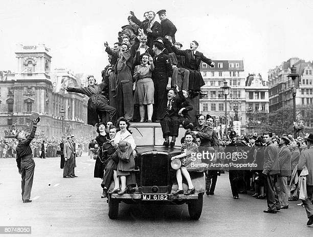 Volume 2 Page 128 Picture 6 World War II People crowd on top of a van during VE Day celebrations London 8th May 1945