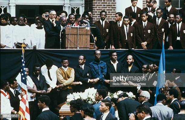 View of Reverend Ralph Abernathy addressing mourners at the funeral of assasinated American minister and civil rights leader Martin Luther King with...