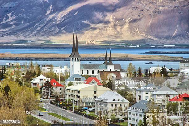 view of reykjavik with hateigskirkja - reykjavik stock pictures, royalty-free photos & images