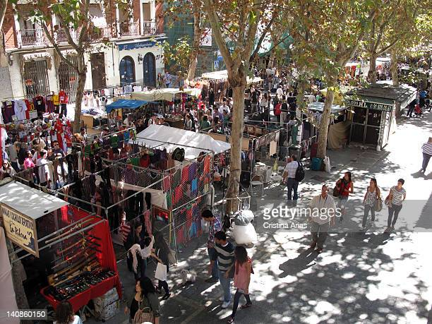 View of Ribera de Curtidores Street with stalls on both sides of the street this street is the main axis of El Rastro in Madrid the traditional...