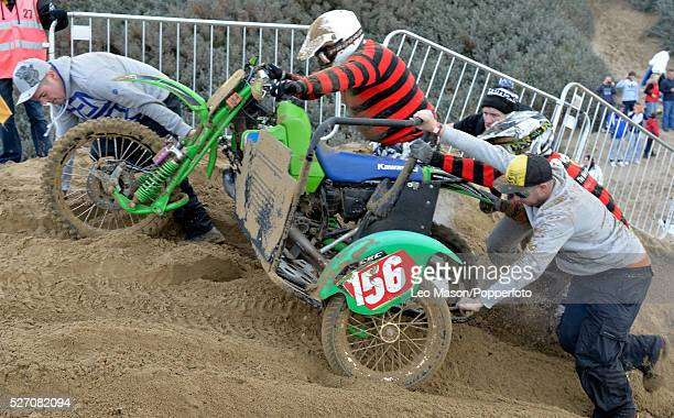 View of riders competing in the Senior Quad bike and sidecar race at the RHL Weston Beach Race in WestonsuperMare England on 12th October 2013