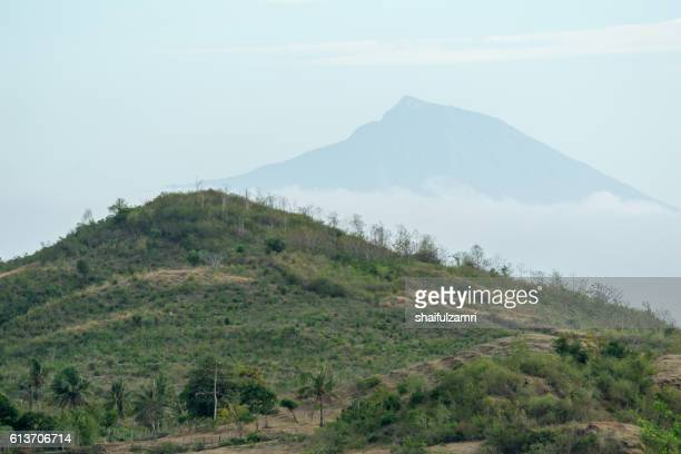 view of rinjani mountain from gerupuk village in lombok island, indonesia - shaifulzamri stock pictures, royalty-free photos & images