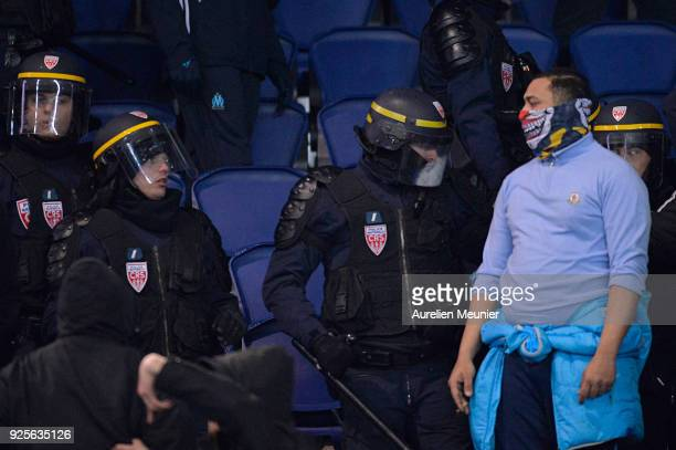 A view of riot police entering the Olympique de Marseille fans tribune to stop them from fighting against Paris SaintGermain supporters during the...