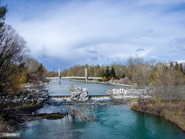 View Of River Against Cloudy Sky During Winter