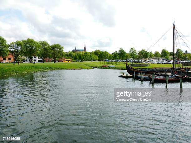 view of river against cloudy sky - roskilde fjord stock pictures, royalty-free photos & images