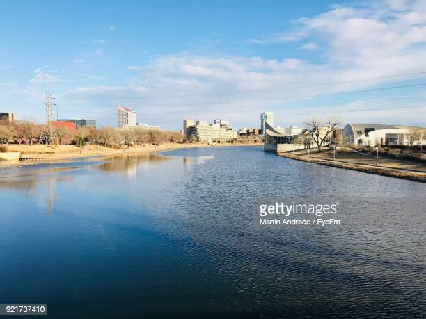 view of river and cityscape against sky - wichita stock pictures, royalty-free photos & images