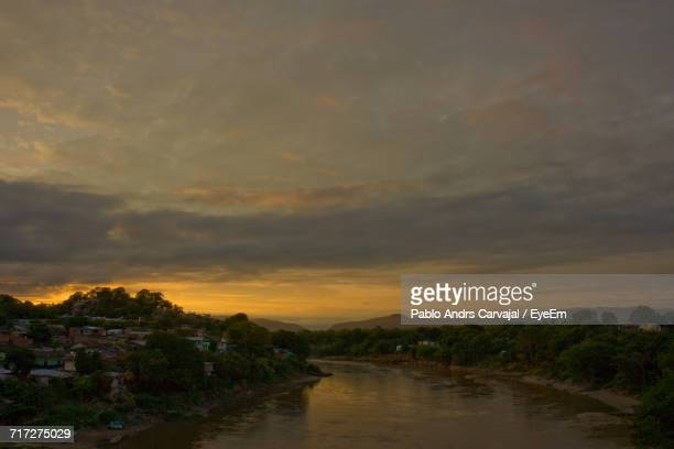 view of river at sunset - carvajal ストックフォトと画像