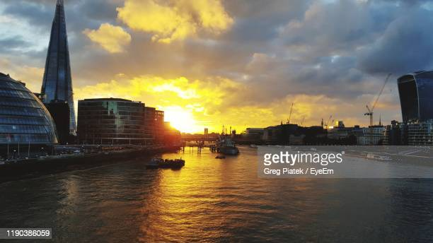 view of river flowing through city during sunset - piatek stock pictures, royalty-free photos & images