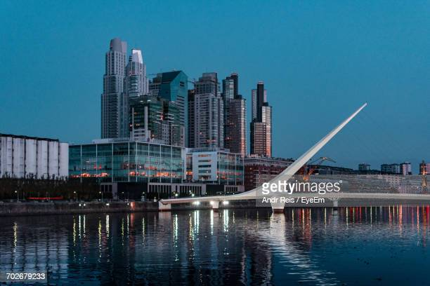 view of river with buildings in background - buenos aires stock pictures, royalty-free photos & images