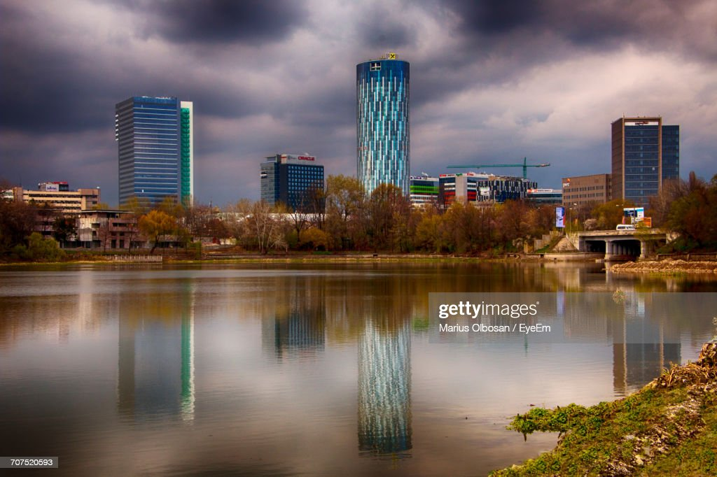 View Of River With Buildings In Background : Stock Photo
