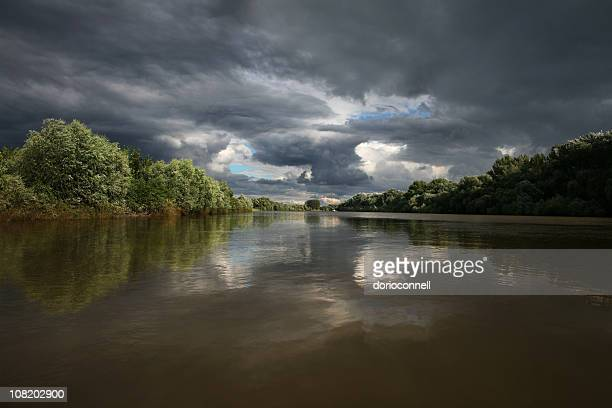 View of River with Overcast Cloudy Sky