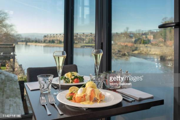 view of river with table setting at italian restaurant - romantic dinner stock pictures, royalty-free photos & images