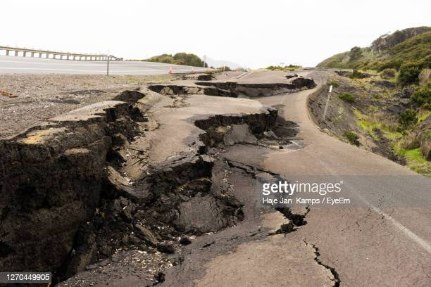 view of road against sky - destruction stock pictures, royalty-free photos & images