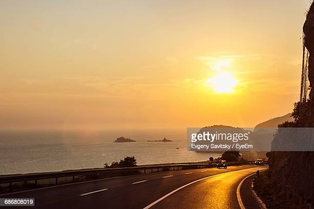 View Of Road At Seaside During Sunset