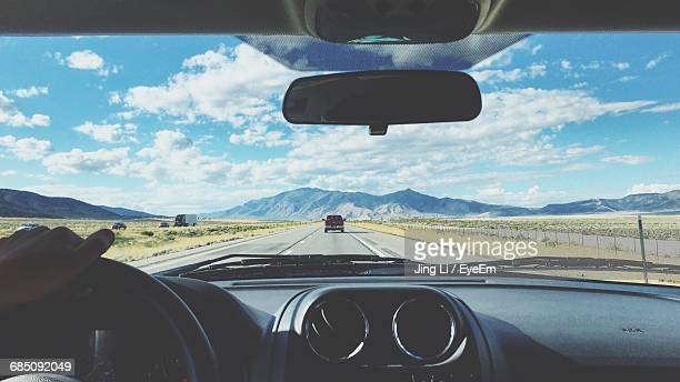 view of road from inside of car - car interior stock pictures, royalty-free photos & images