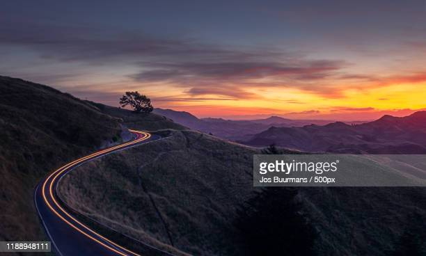 view of road in mountains te mata peak, havelock north, hastings, new zealand - images stock pictures, royalty-free photos & images