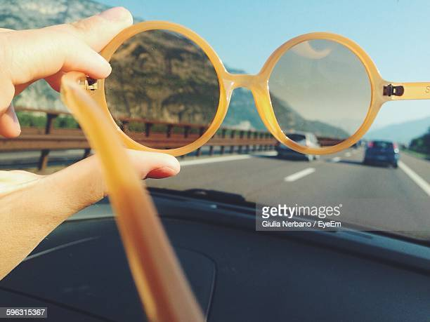 view of road seen through sunglasses - unusual angle stock pictures, royalty-free photos & images