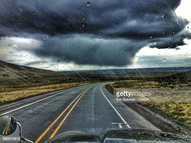 View Of Road Through From Car Windshield