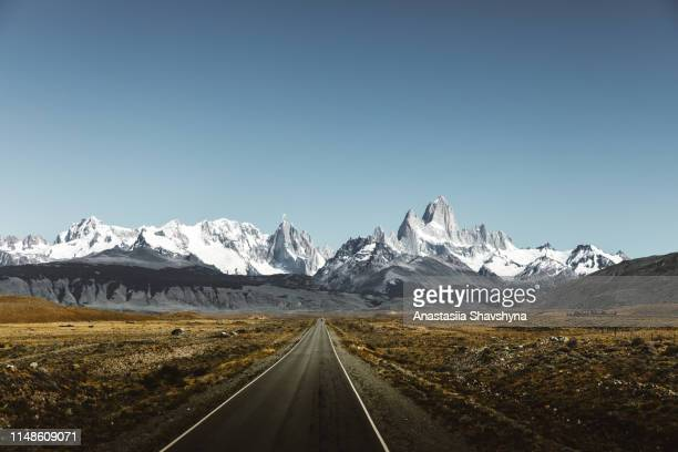 view of road to fitz roy in patagonia - mountain stock pictures, royalty-free photos & images