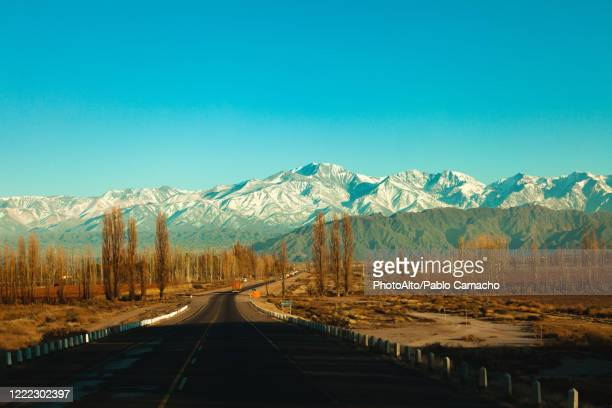 view of road with mountains - chile stock pictures, royalty-free photos & images