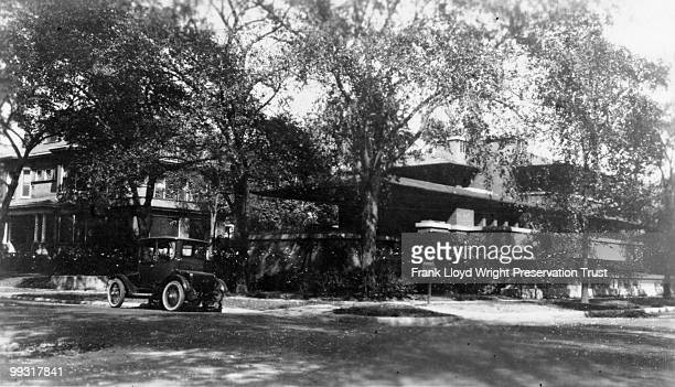 View of Robie from southwest with owner Isadora Wilber's electric car parked in front on Woodlawn Chicago Illinois 1925