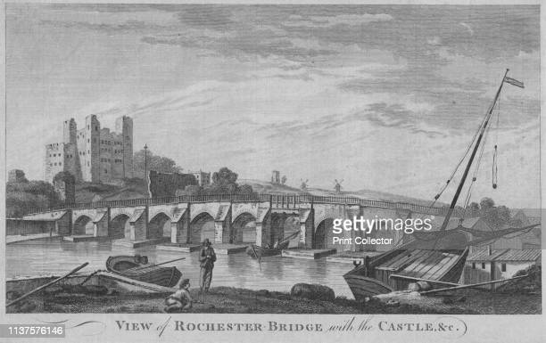 View of Rochester Bridge with the Castle c' 1779 Rochester Bridge over the River Medway in Kent with boats in the foreground and Rocheter Castle in...